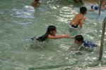 Alessia and Luke playing in the pool at the Apex