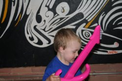 Spencer playing with a guitar