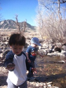 Tao and Spencer playing with rocks