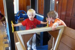 Isaac and Aaron in the playhouse train