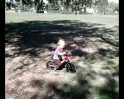 Spencer riding his strider bike