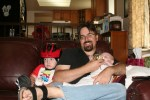 Rob cuddling with the kids on the couch
