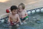 Spencer and Tao playing in the pool