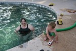 Clare and Spencer playing in the pool