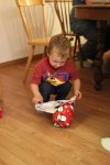 Spencer opening a present