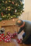 Dave geting presents from under the tree