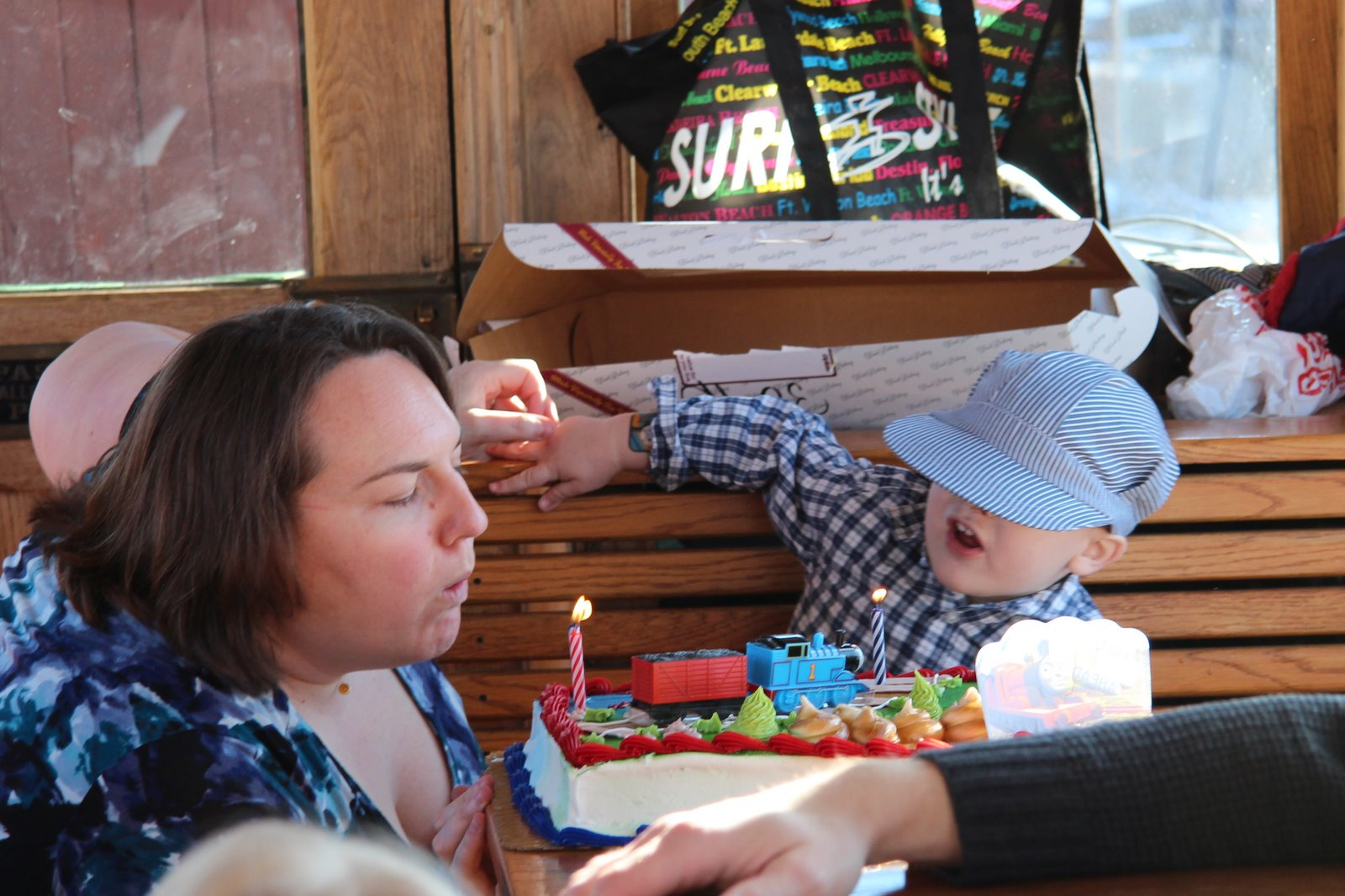 Spencer and Clare blowing out the candles