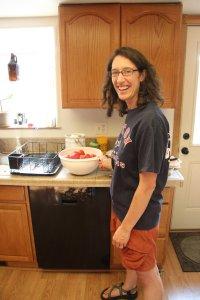 Mekayla and a big bowl of peeled tomatoes