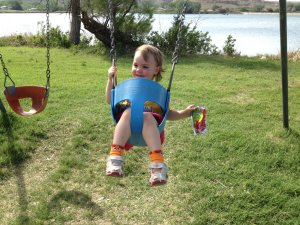Meg on a swing by the lake