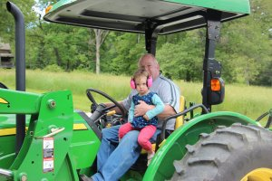 Despite her intense look, Meg really love the tractor rides