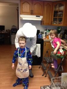 Rob ties Spencer's apron
