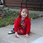 Meg drawing with sidewalk chalk