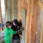 Spencer helps grandpa put in some insulation