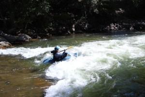 Rick kayaking in some rapids