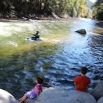 The kids watching Rick kayak
