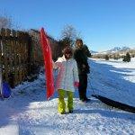 Grace and Bret sledding