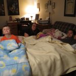 Spencer, Clare, Meg, and Sadie getting ready for bed
