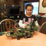 Sadie playing with a construx truck