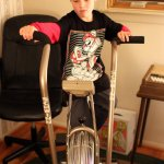 Spencer tries the exercise bike