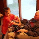 Spencer showing Grandpa Felty some construx jet