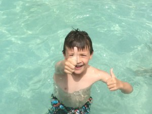 Spencer gives a thumbs up at the pool