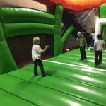 Spencer and Aaron playing bouncy house dodge ball