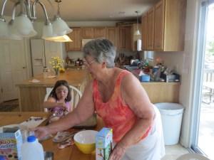 Grandma teaches the kids how to make pudding
