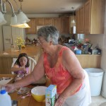 Grandma teaches the kids how to make pudding