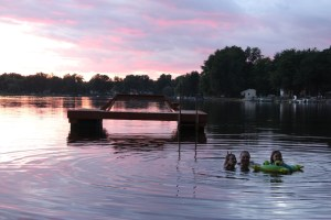 Spencer, Clare, and Meg in horseshoe lake at sunset