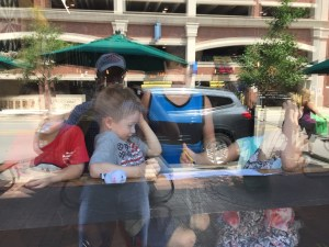 Elliot, Marcel, Spencer, Meg and Rob's reflection in the window at ABC