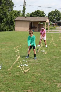 Spencer and Sadie on the driving range