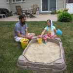 Rob and Meg making sand cakes