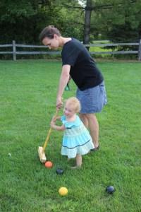 Casey teaching Helen croquet