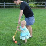 Casey teaching Helen croquet