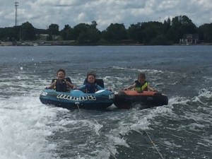 Spencer, Meg, and Luuk catching some waves on the tubes