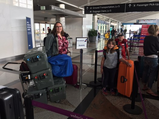 Clare, Meg, and Spencer checking in for flight