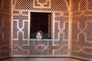 Meg peeking through a partial wall