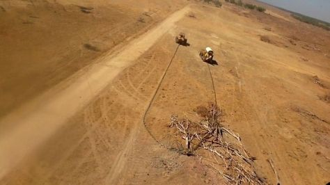 Bulldozers and chains being used to clear vegetation in Queensland. The loss of native vegetation undermines efforts to tackle climate change.