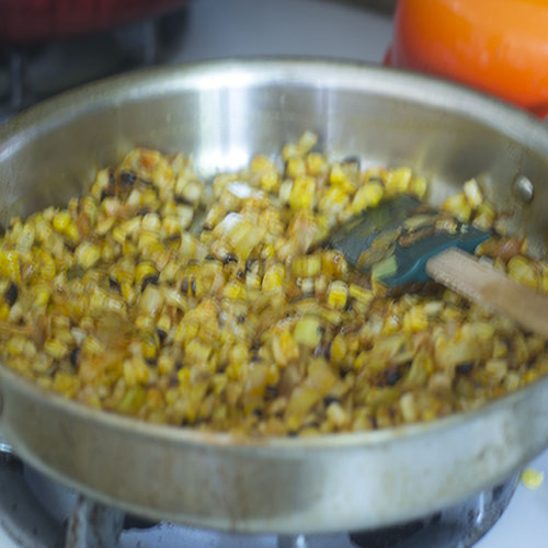 Corn Added to Leeks and Spices