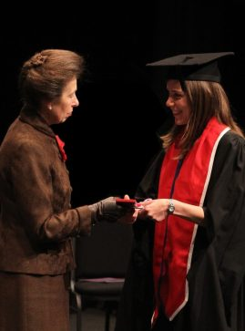 Warwickshire osteopath Emma Lipson receives Silver Medal from Princess Anne