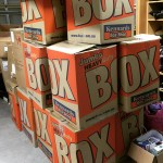 This is an image of lots of boxes containing Winter Care Kits for KiC, donated from Kennards Brookvale
