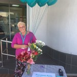This is an image of RLOA giving away flowers and balloons during FGF