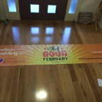 This is an image of a very long Feel Good Feb banner donated by Signmaker Solutions
