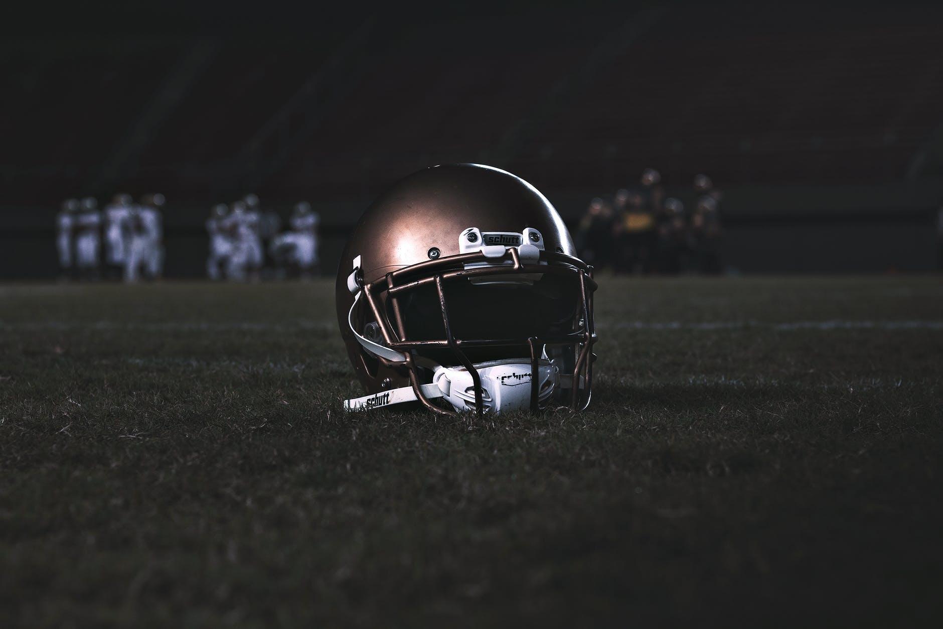 Football helmet on the ground
