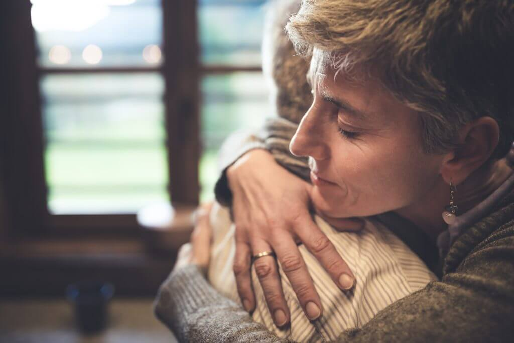 Woman embracing another person