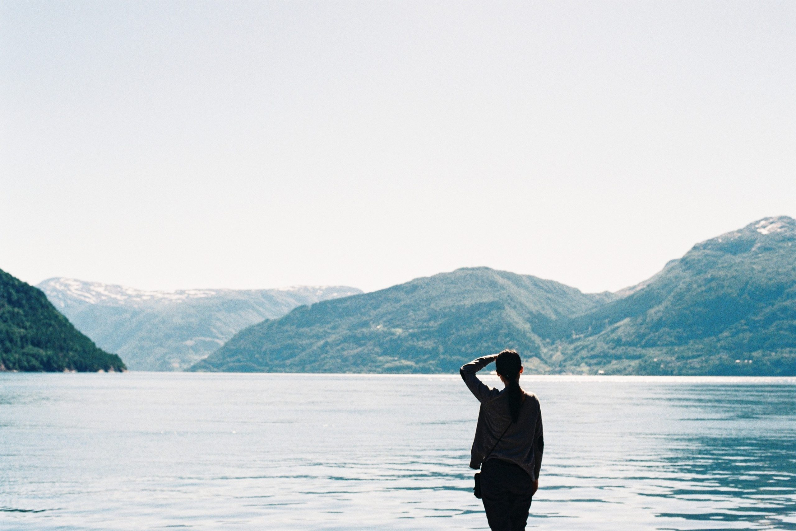 Woman looking out at a large body of water