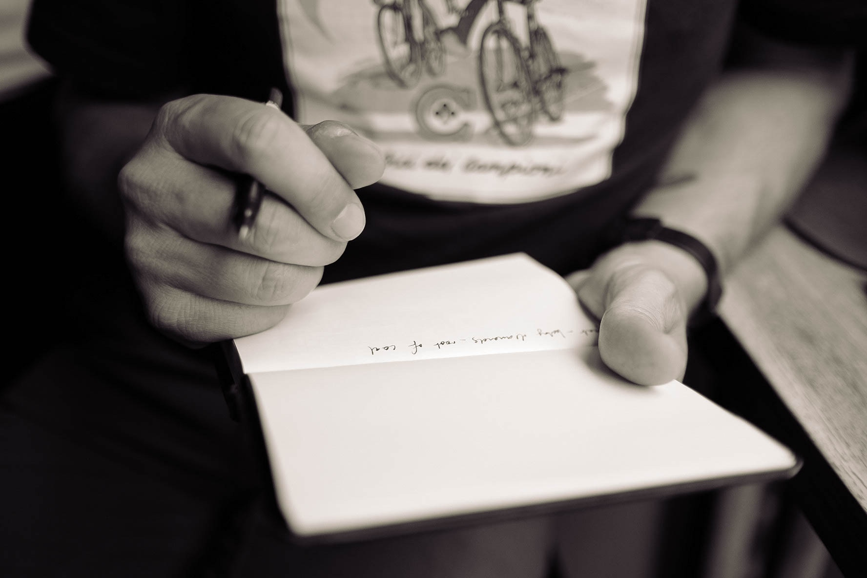 Close up of someone writing in a notebook
