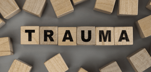 Wooden blocks with letters on them that spell out trauma