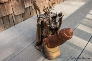 Exotic Erotic's Wraith dildo, coming out of the crotch of a statue of Loki