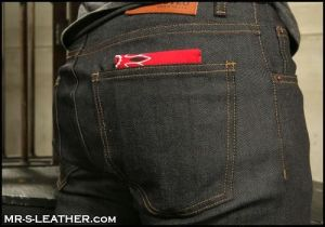 A closeup of someone's butt. A wallet is sticking out of their pocket with a red hanky code pattern on it